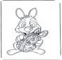 Conejo de Pascua con huevo