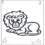 Animales - León tendido