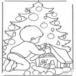 Navidad - Niño junto al árbol
